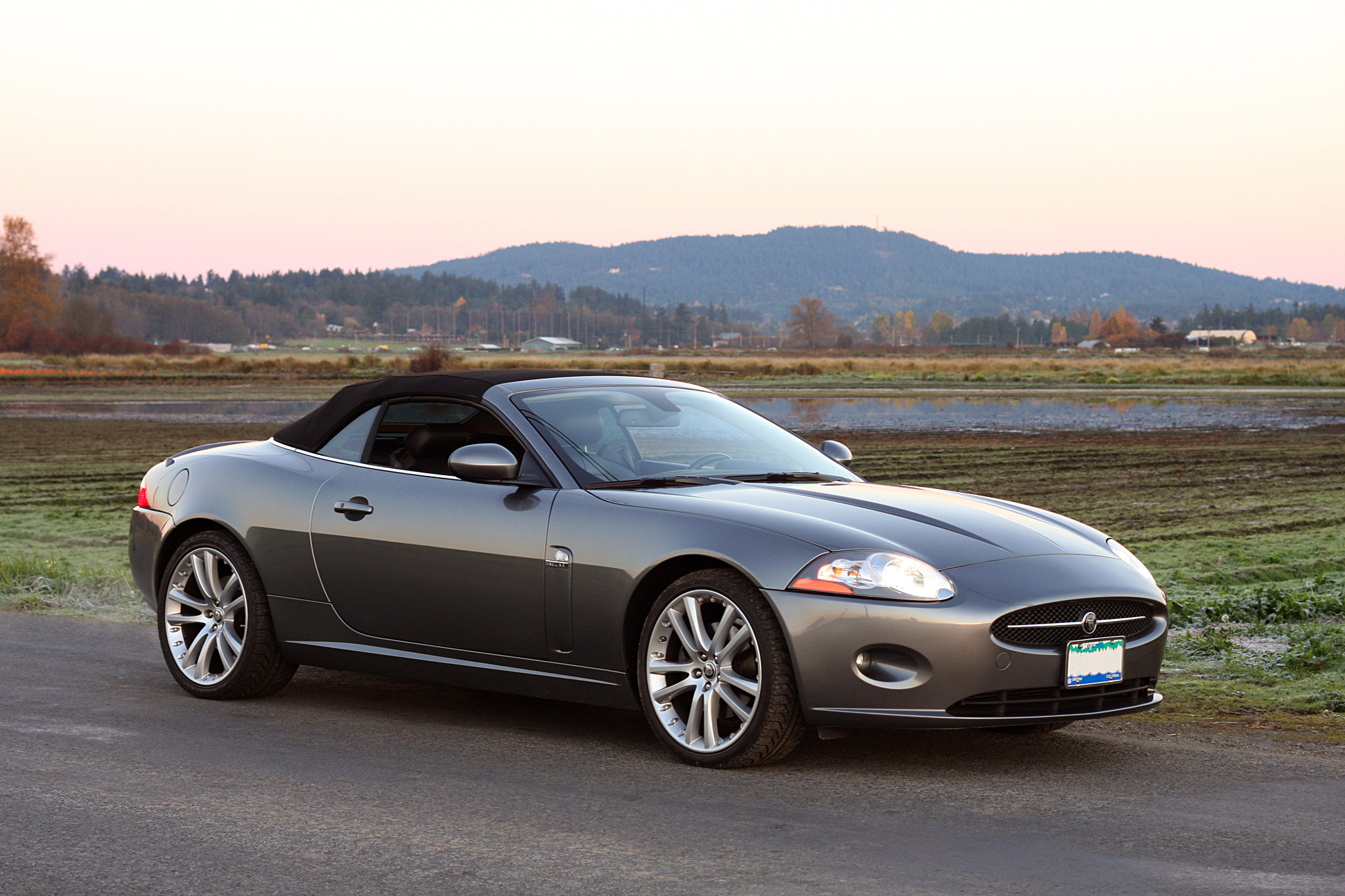 Convertible Top Raises Or Lowers In 18 Seconds.  Jaguar 4.2 Litre 300 Hp  V8  6 Speed Automatic Transmission With Paddle Shifters.