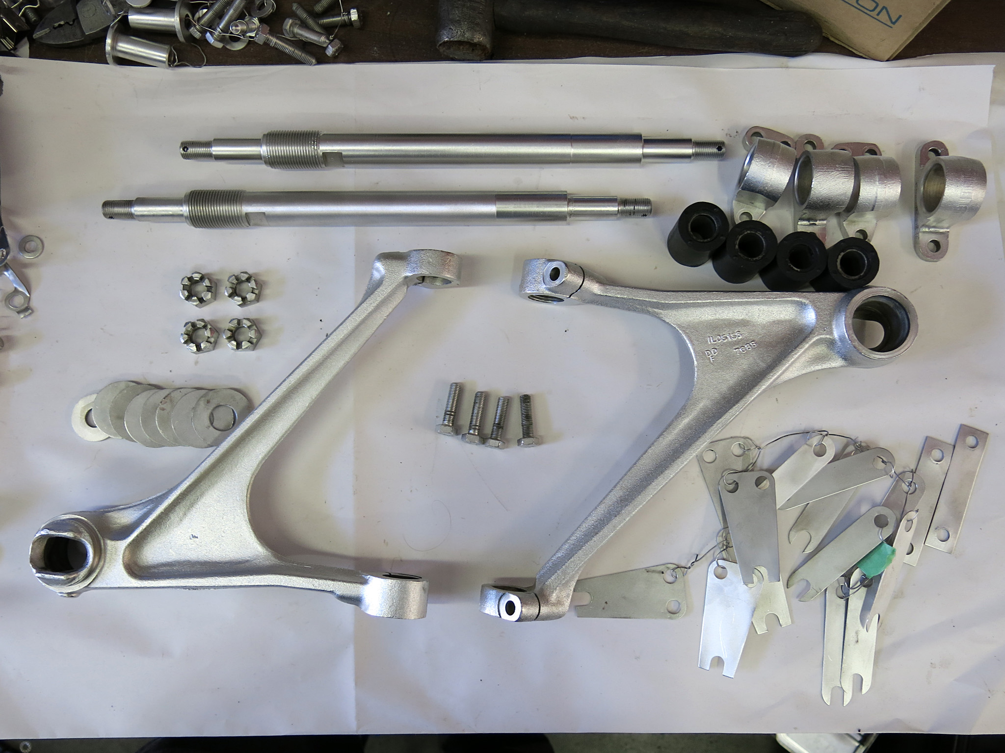 Plated pieces for the upper control arm were restored by Electroshine Metal Refinshers Ltd.  Their fine work reveals all the intricate machining of these parts. These were CAD plated without ACID pickling to avoid embrittlement. Original finish from 1965 was bright silver zinc .