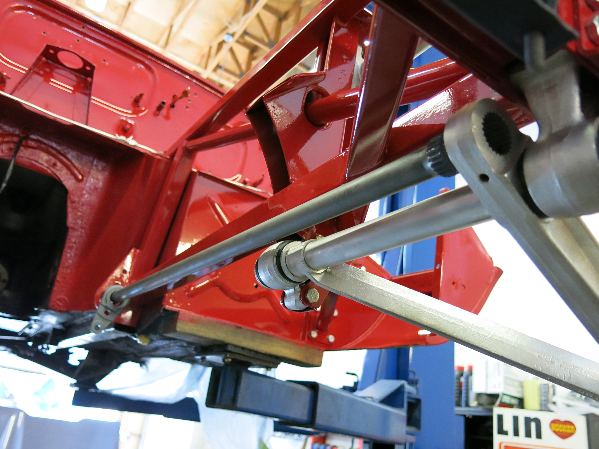 Install the lower control arms with the torsion bars in the correct factory fit. We slid the torsion bar receiving bracket into the middle of the bar, then pushed the torsion bar into the lower control arm and finally pushed the bracket into place.
