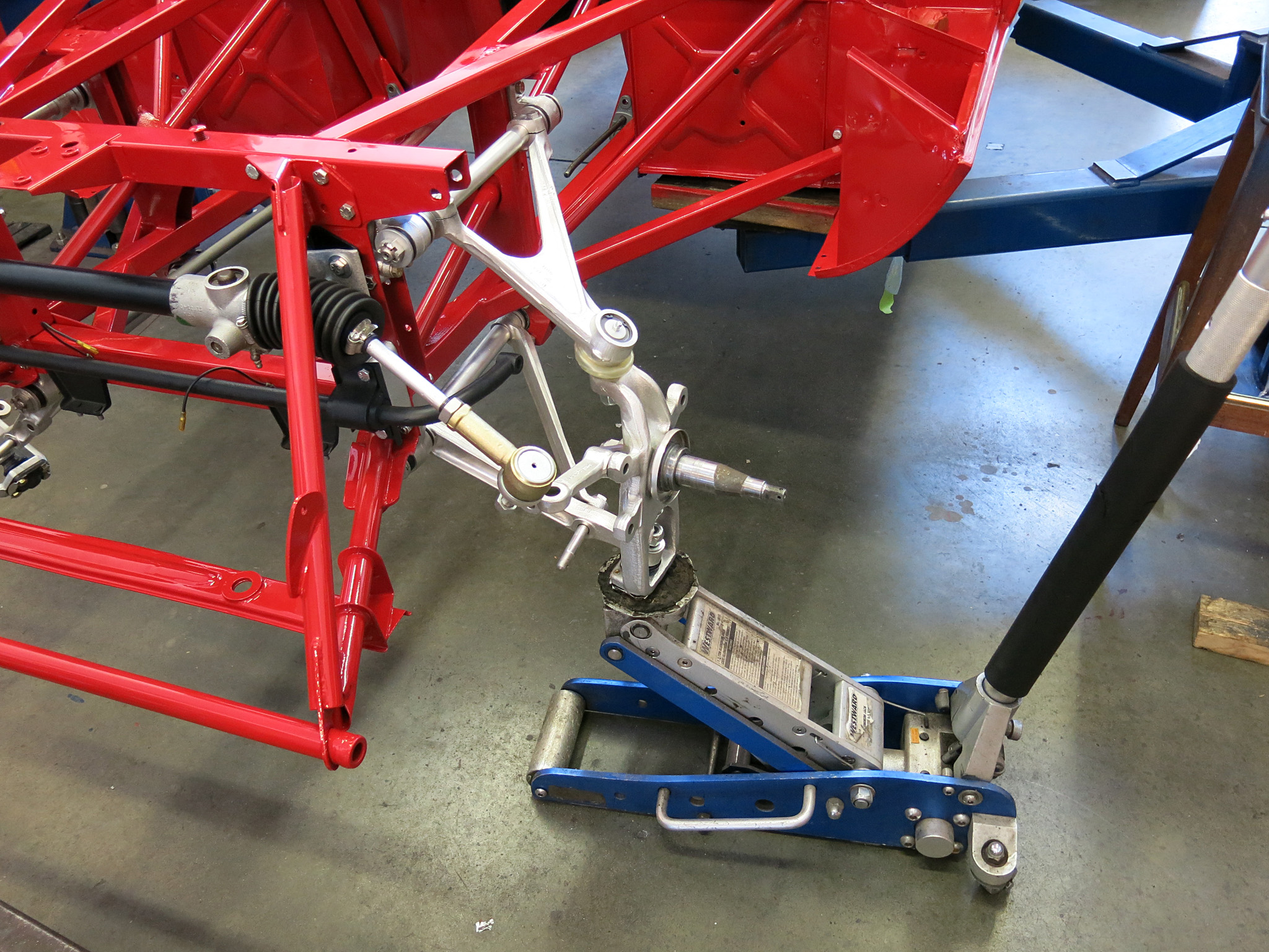 STEP 18 - The next couple steps link up the rest of the suspension with the jack pre-loading the torsion bar. Loosely attach the stub axle carriers with the provided (hopefully) nyloc nut to the lower control arm. With a jack and the car's weight you can mate up the top control arm.