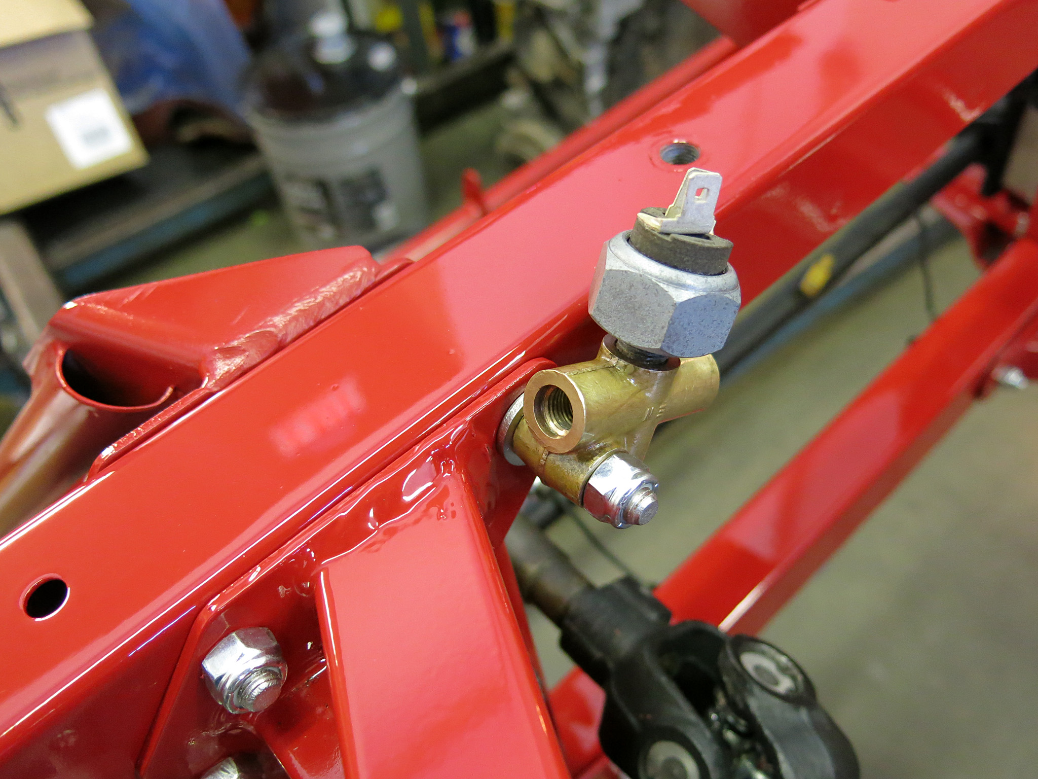 Step 7.5 - Install the same two inner bolts on the driver's side which also incorporates the 3-way hydraulic union .